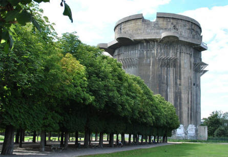 A round flak (anti-aircraft) tower in the Augarten Park in Vienna. Notice the size compared to the trees.