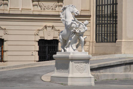 One of the many historical statues displayed outside the Upper Belvedere Castle in Vienna.