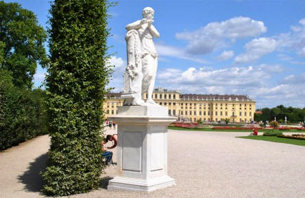 One of the many sculptures in the park of the Schönbrunn Palace in Vienna - with the palace in the background.