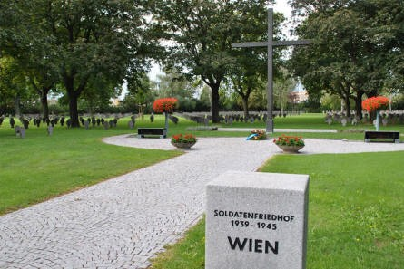 Some of the many German World War II graves at the Vienna German War Cemetery - and the Cross of Sacrifice.