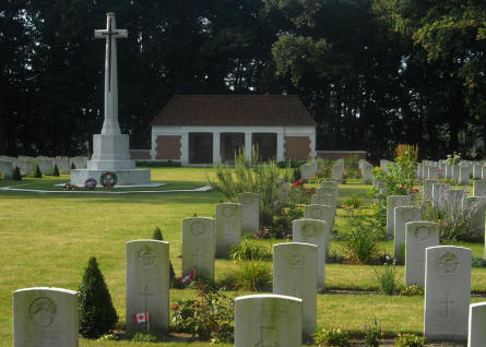 Some of the many war graves at the Adegem Canadian War Cemetery - and the central cross at the cemetery.