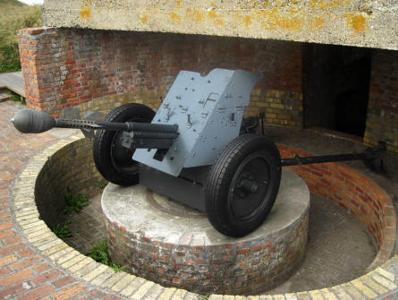 A German World War II PAK 36 anti-tank gun - with a 3.7cm Steilgranate 41 grenade - displayed at the Raversijde Domain (Atlantic Wall museum) at Oostende.
