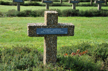 The World War II grave of a German soldier - killed in 1943 - at the Lommel German War Cemetery.