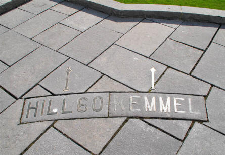 An arrow in the pavement at the Canadian Hill 62 (Sanctuary Wood) Memorial points in the direction of Hill 60 and Kemmel - two other strongholds outside Ypres during World War I.
