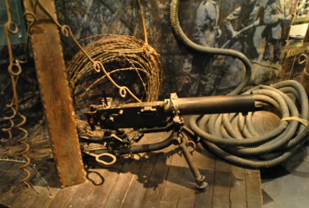A machine gun and barbed wire displayed at the In Flanders Fields Museum in Ypres. Both of these played a huge role during World War I.
