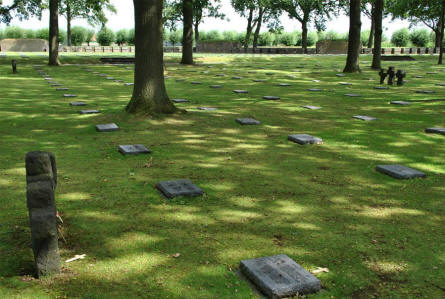 The Langemark German War Graves is a typical German military cemetery - with dark grave stones lying flat on the ground and a few dark crosses.