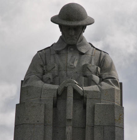Close-up of the figure on top of statue at The St. Julien Memorial.