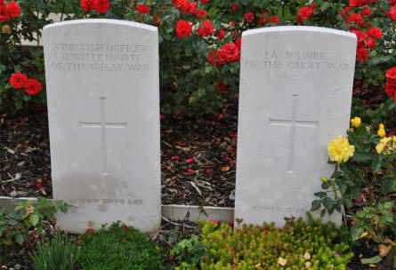 "Two graves of ""unknown"" soldiers - ""A British Officer (Lieutenant) of the Great War"" and ""A soldier of the Great War"" - at the Tyne Cot War Cemetery near Zonnebeke."
