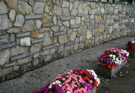 The names of the soldiers that were murdered can be seen on the wall at the Malmedy Massacre Memorial.