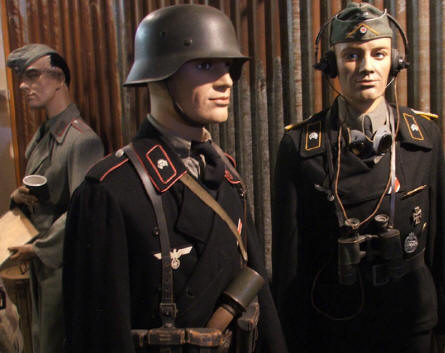German World War II soldier displayed in black panzer uniforms at the December 1944 Museum in La Gleize.