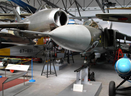 A vintage MIG jet fighter and a more modern MIG-23 jet fighter displayed at the Aviation museum Kbely in Prague.