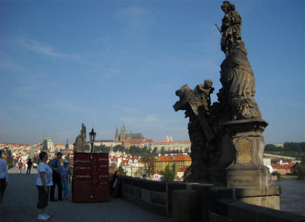 Some of the many statues on the Charles Bridge in Prague - with the Prague Castle in the background.