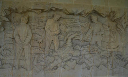 One of the reliefs on the large memorial wall at the Lidice Memorial - showing the massacre at Lidice in 1942.