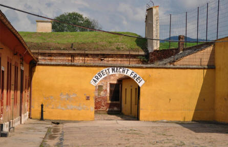 "A gate with the slogan ""Arbeit macht frei"" (Work Brings Freedom) in the old part of the Theresienstadt Concentration Camp in Terezin. This part of the camp is called Small Fortress."