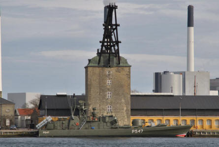 "The ""Cold War"" Danish torpedo/missile boat ""HDMS Sehested (P 547)"" at the old Danish Naval Base ""Holmen"" in Copenhagen. This boat was in service with the Danish Navy from 1977 until 2000. This type was called the Willemoes class missile boat."