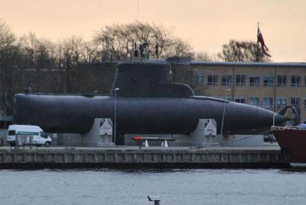 "The ""Cold War""  Danish submarine ""Sælen"" (""the Seal"") displayed at the old Danish Naval Base ""Holmen"" in Copenhagen. The submarine was in active service from 1965 until 2004. Notice the torpedo in front of it."
