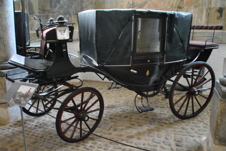 One of the beautiful old carriages displayed at the Museum Royal Stables and Carriages in Copenhagen.