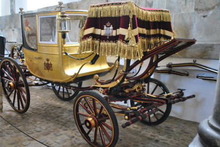 One of the beautiful old gold carriages displayed at the Museum Royal Stables and Carriages in Copenhagen.