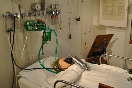 A more modern hospital bed displayed as a part of the medical collection at the Steno Museum in Aarhus.