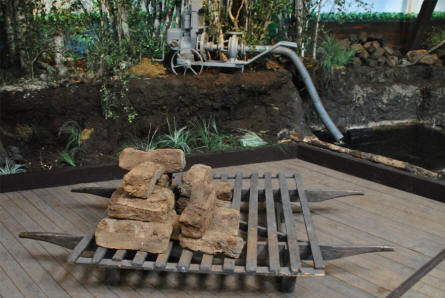 A vintage peat digging sledge displayed at the Stenvad Peat Digging Museum.