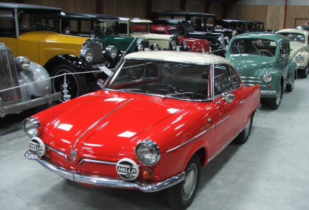 Some of the many different cars (NSU, Renault, VW Beatle and many other) on display at Jysk Automobile Museum.