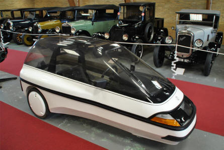 "A small 1980's Danish built electrical vehicle - called an ""Ellert"" - displayed at the Jysk Automobile Museum."