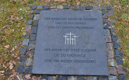 "A stone at the Frederikshavn War Cemetery telling that ""Here rests 1,220 German soldiers and 232 refugees - Victims of World War II""."