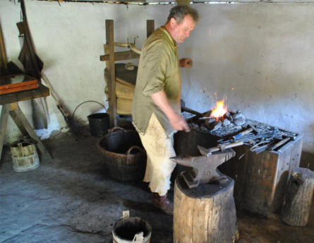 A blacksmith working at the Fyrkat Viking Centre in Hobro.