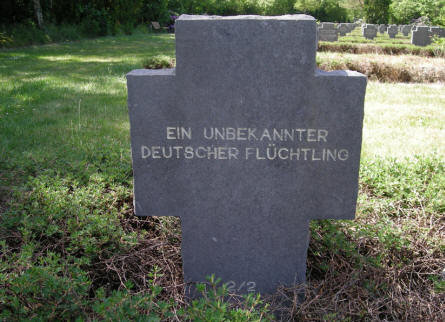 The grave of an unknown German refuge at Grove War Cemetery.