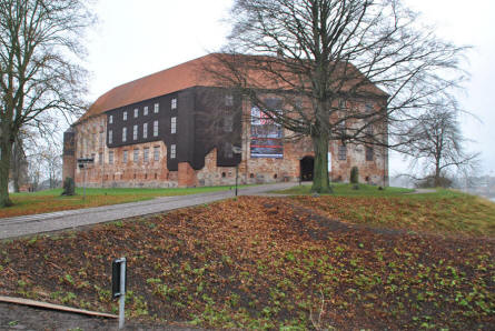 The Koldinghus Castle in Kolding seen from the parking lot nearby. The dark brown surface is wood. This was used to restore the original ruin in order keep an impression of the extend of the fire lay the castle in ruins in 1808.
