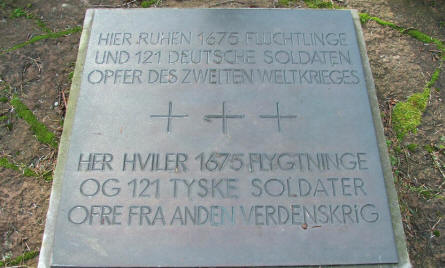 A sign at Oksbøl German War Cemetery telling that 1675 German refugees and 121 German soldiers are buried here.