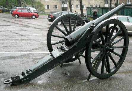 A vintage canon displayed outside the Helsinki Military Museum.