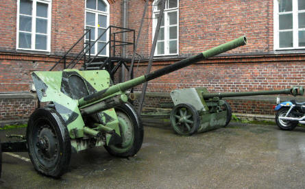 Two of the canons displayed outside the Helsinki Military Museum.
