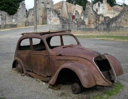The doctors car let a the central square at Oradour-sur-Glane. It has been there since the SS raid on the 10th of June 1944.