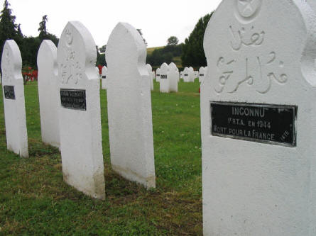 "Some French Muslim graves at  Rougemont French War Cemetery. The grave to the right is an ""unknown soldier""."