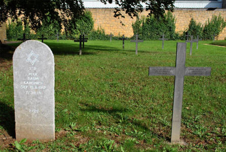 Two of the many German World War I graves at the Briey German War Cemetery. One Jewish grave stone and some Christian crosses.