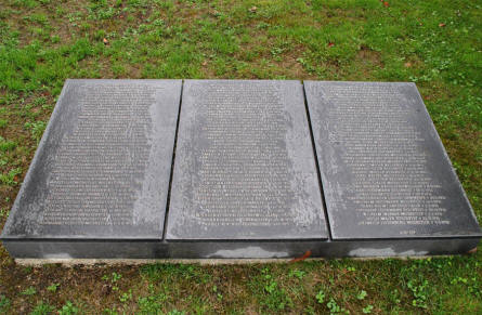 One of the many German World War I memorial stones at the Consenvoye German War Cemetery. Each memorial stone holds the names of a number of German soldiers that were killed during World War I.