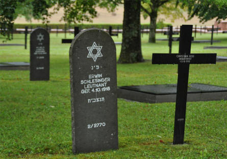 Some of the many German World War I graves at the Consenvoye German War Cemetery. Jewish gravestones, Christian crosses and memorial stones at the ground.