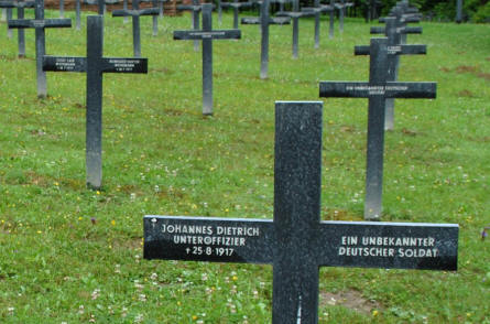 "Some of the many German World War I graves at the Épinonville German War Cemetery. In the front a grave for a German soldier that was killed in 1917 and an ""unknown"" German soldier."