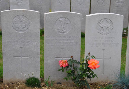 The World War I grave of Flight Sub-Lieutenant R. W. Berridge (Royal Naval Air Service - killed 3rd of May 1917) and two other graves at the Bray Military Cemetery at Bray-sur-Somme.