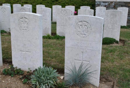 "The World War I graves of an ""unknown"" soldier and Second Lieutenant L. F. Cooke (killed on the 26th of September 1916) at the Bray Vale British Cemetery at Bray-sur-Somme."