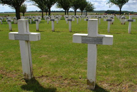 Two of the French World War I graves at the Dompierre-Becquincourt Cemetery.