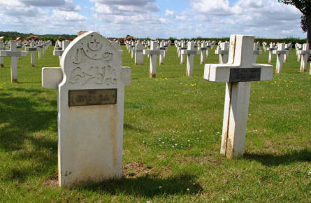 Two of the French World War I graves at the Dompierre-Becquincourt Cemetery. One Muslim and one Christian gravestone.