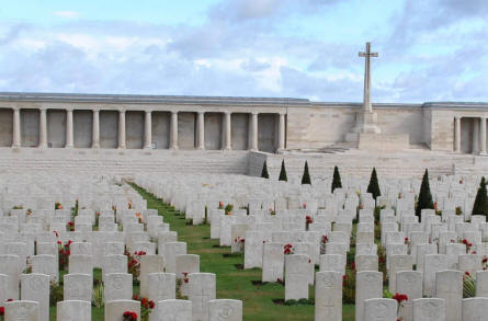 A section of the Pozieres British Cemetery, where the graves a very close. In the background a section of the Pozieres British Memorial.