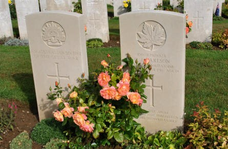 "The World War I graves of an ""unknown"" Australian soldier and a ""knoen"" Canadian soldier at the Pozieres British Cemetery."