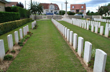 Some of the many World War I graves at the Querrieu British Cemetery. In the background the Cross of Sacrifice.