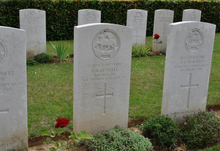 The World War I grave of Second Lieutenant H. Marshall (killed 1st of August 1918) at the Querrieu British Cemetery.