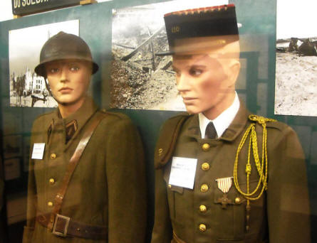 French World War II uniforms displayed at the Calais War Museum.