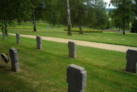 Some of the many headstones at the Noyers-Pont-Maugis German War Cemetery. Notice the stones the are one the ground further down the hillside.