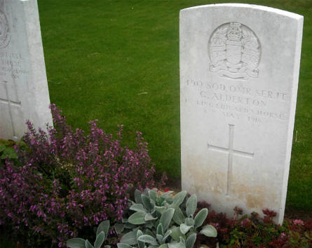 One of the British World War I graves located on the Quatre Vents Military Cemetery in Estree-Cauchy.